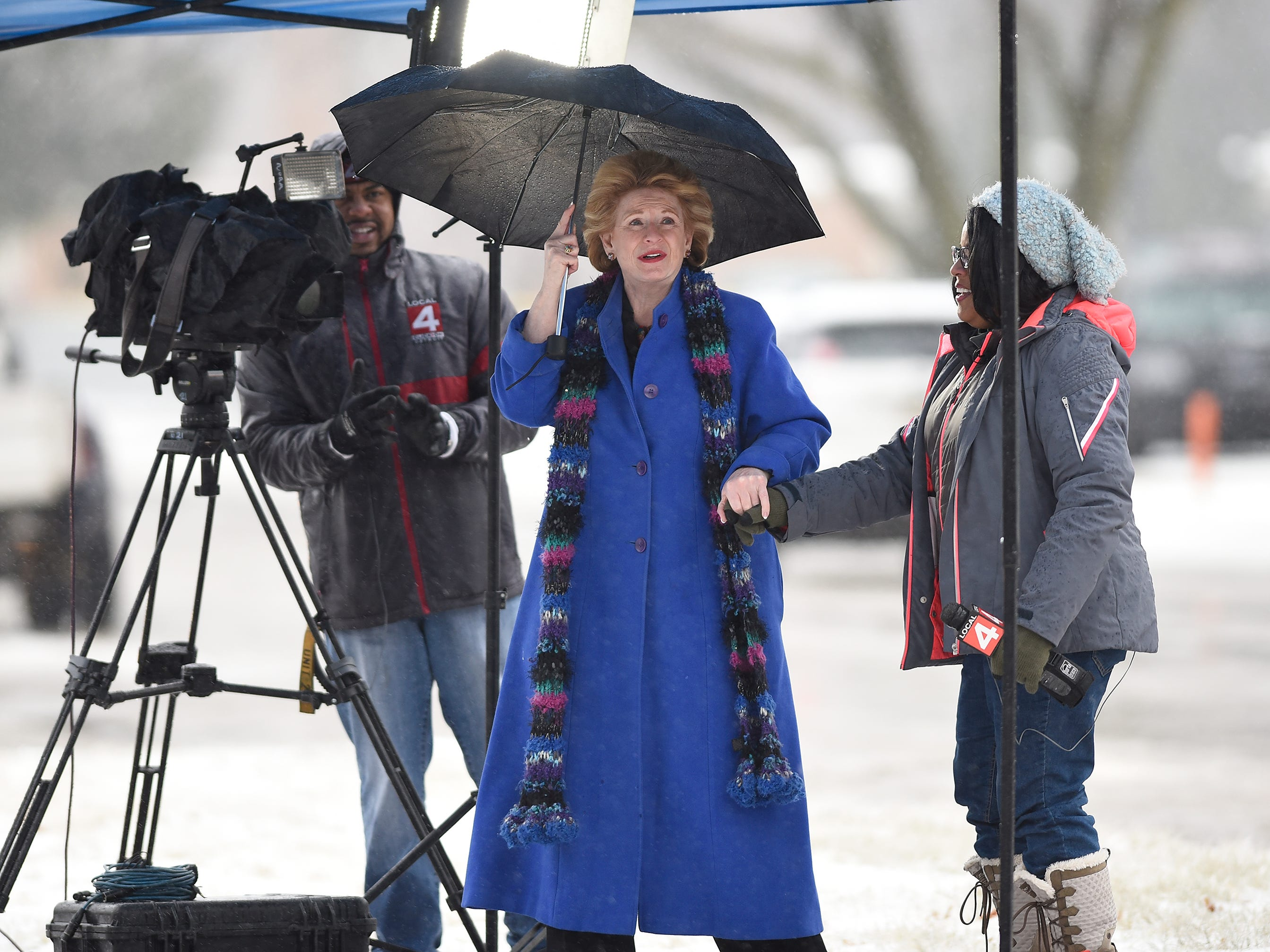 U.S. Senator Debbie Stabenow prepares to do a interview with WDIV reporter Paula Tutman before the start of the funeral of John D. Dingell.