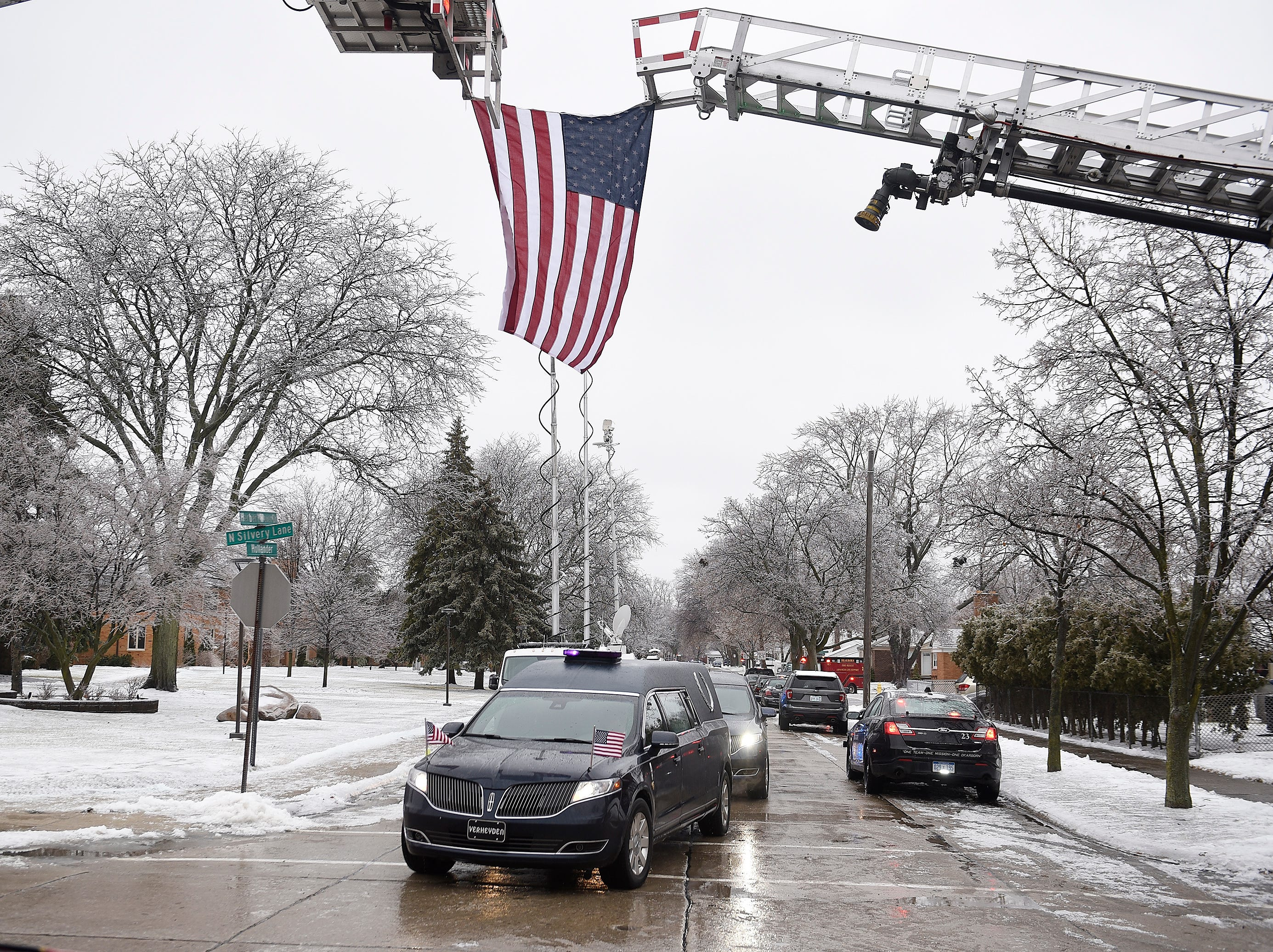 The hearse carrying the casket of John D. Dingell arrives at the Church of the Divine Child for his funeral.***Funeral Services for John D. Dingell at the Church of the Divine Child.,February 12, 2019, Dearborn, Mi. (Clarence Tabb Jr./The Detroit News)