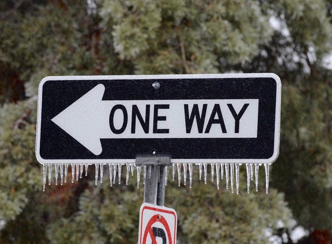 An ice covered road sign along S. Stephenson Highway in Royal Oak signals an overnight ice storm has occurred on Tuesday, February 12, 2019.