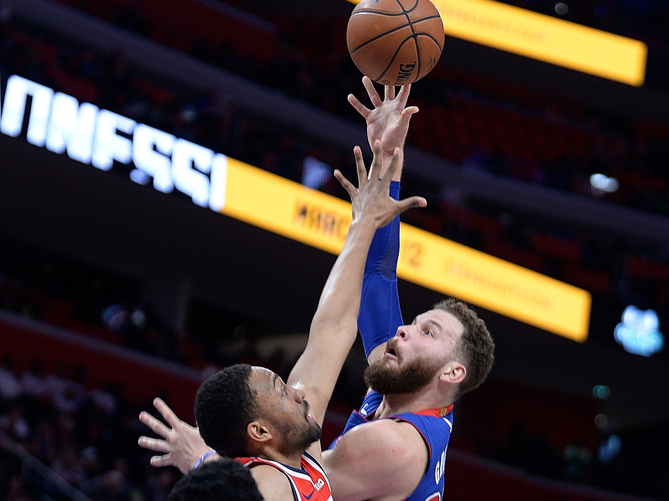Pistons' Blake Griffin scores over Wizards' Jabari Parker in the second quarter.