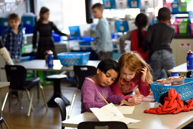 Gill Elementary kindergarten students Sampada Raut, left, and Breanne Reynolds work together on a sketch as other students find ways to pass time, Monday, Feb. 11, 2019 in Farmington Hills, Mich.