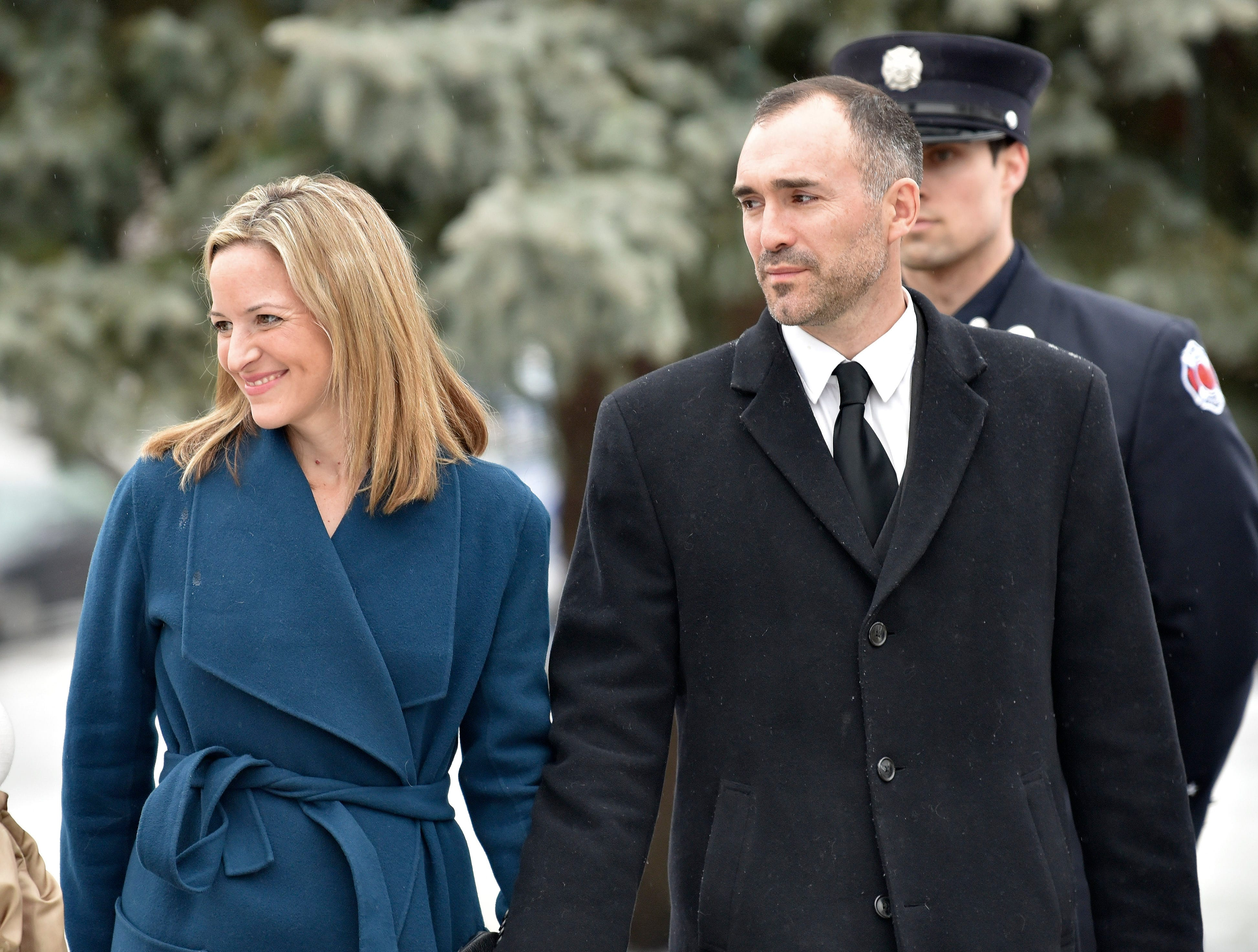 Michigan Secretary of State Jocelyn Benson, left, leaves the funeral mass.