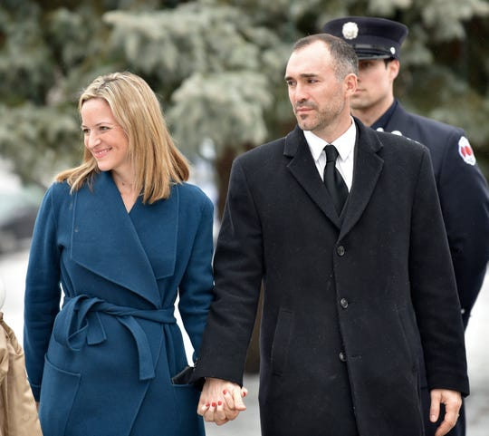 Michigan Secretary of State Jocelyn Benson and her husband Ryan Friedrichs leave the Church of the Divine Child in Dearborn on Tuesday, Feb. 12, 2019, after a funeral mass for former Congressman John Dingell. Benson released a voluntary personal financial disclosure Thursday in an effort to increase transparency in government.