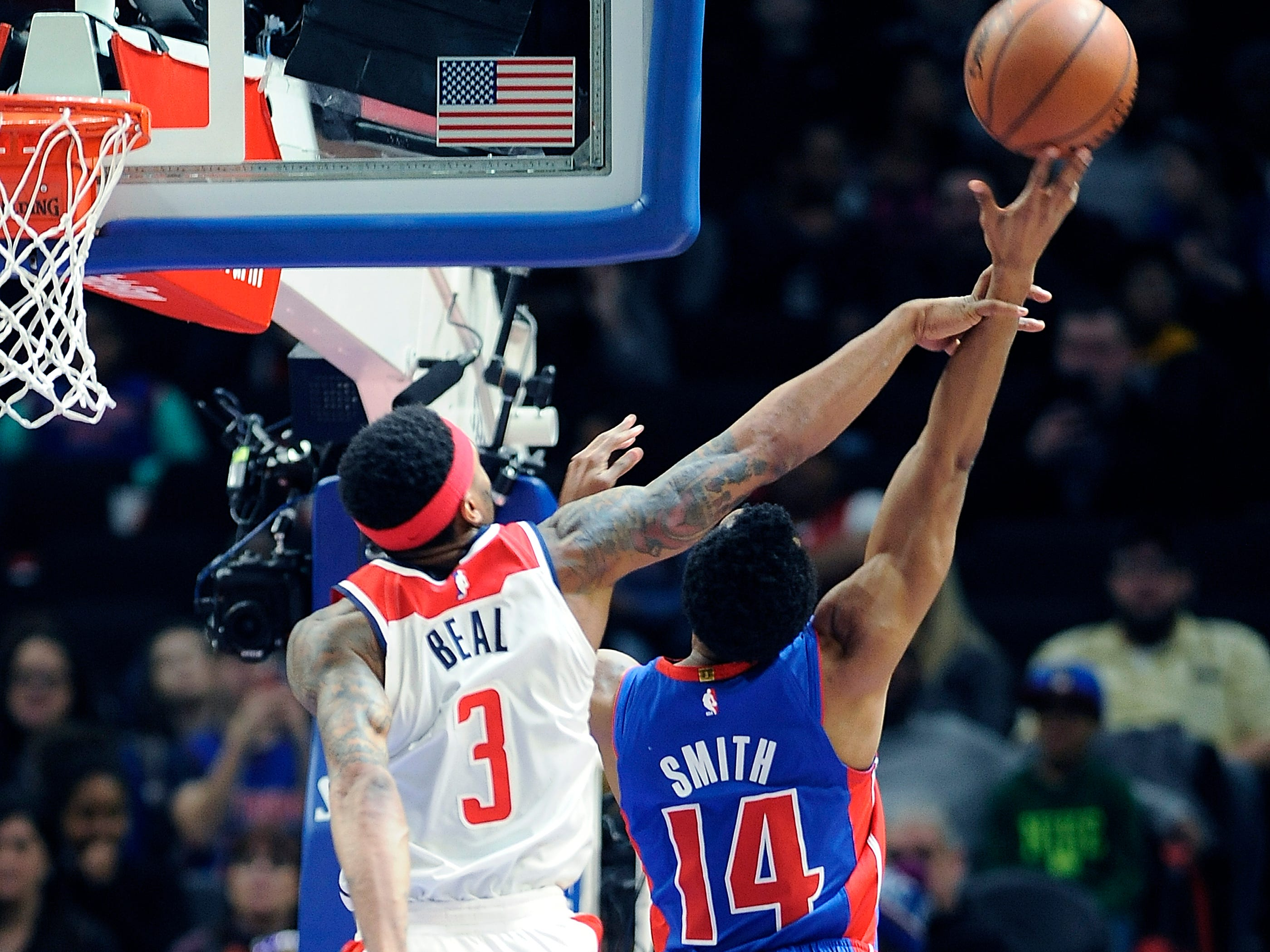 Wizards' Bradley Beal fouls Pistons' Ish Smith in the fourth quarter.