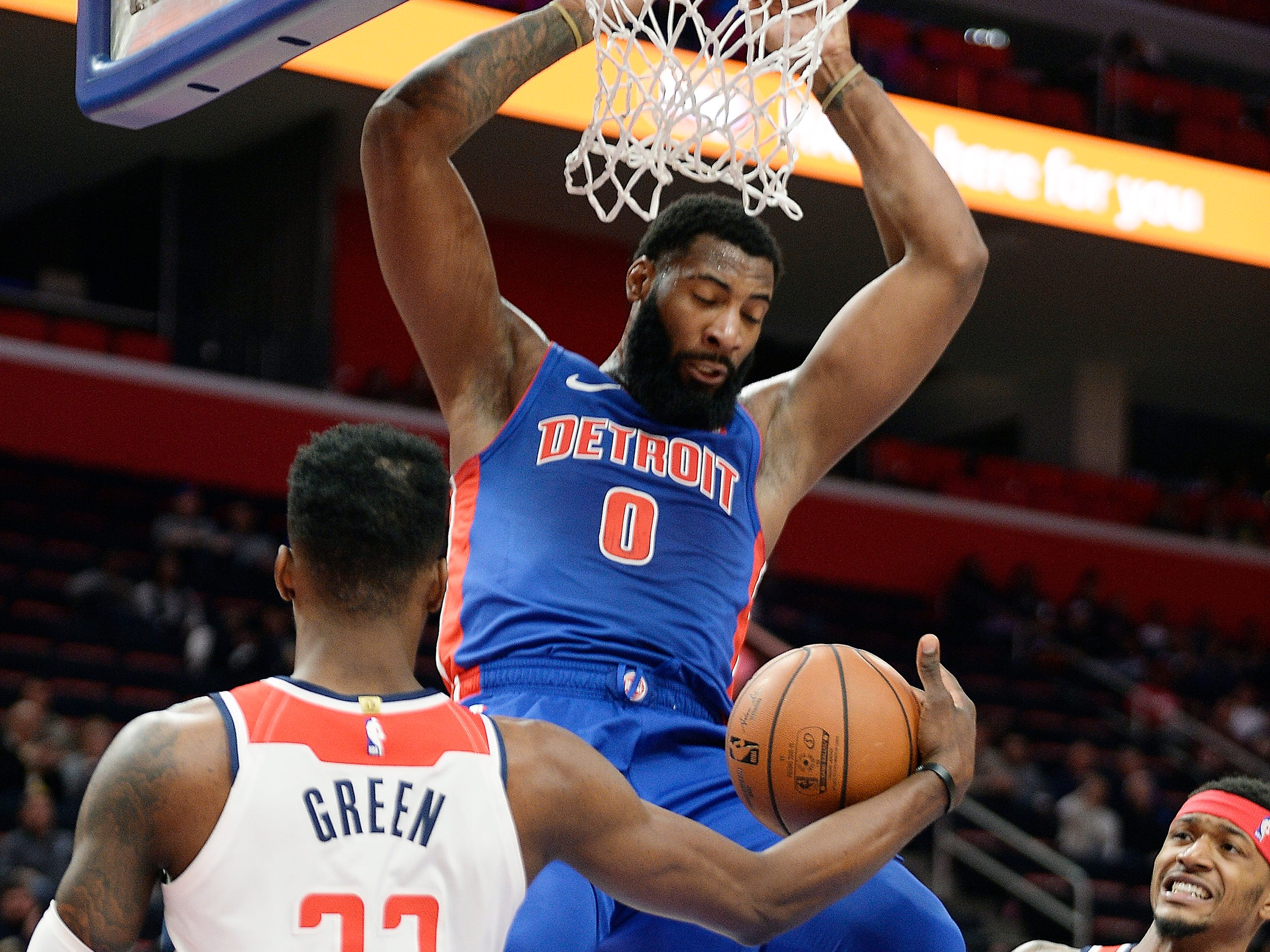 Pistons' Andre Drummond dunks over Wizards' Jeff Green in the second quarter.  Detroit Pistons vs Washington Wizards, Little Caesars Arena., February 11, 2019, Detroit, Mi.