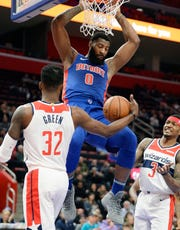 Pistons' Andre Drummond dunks over Wizards' Jeff Green in the second quarter.