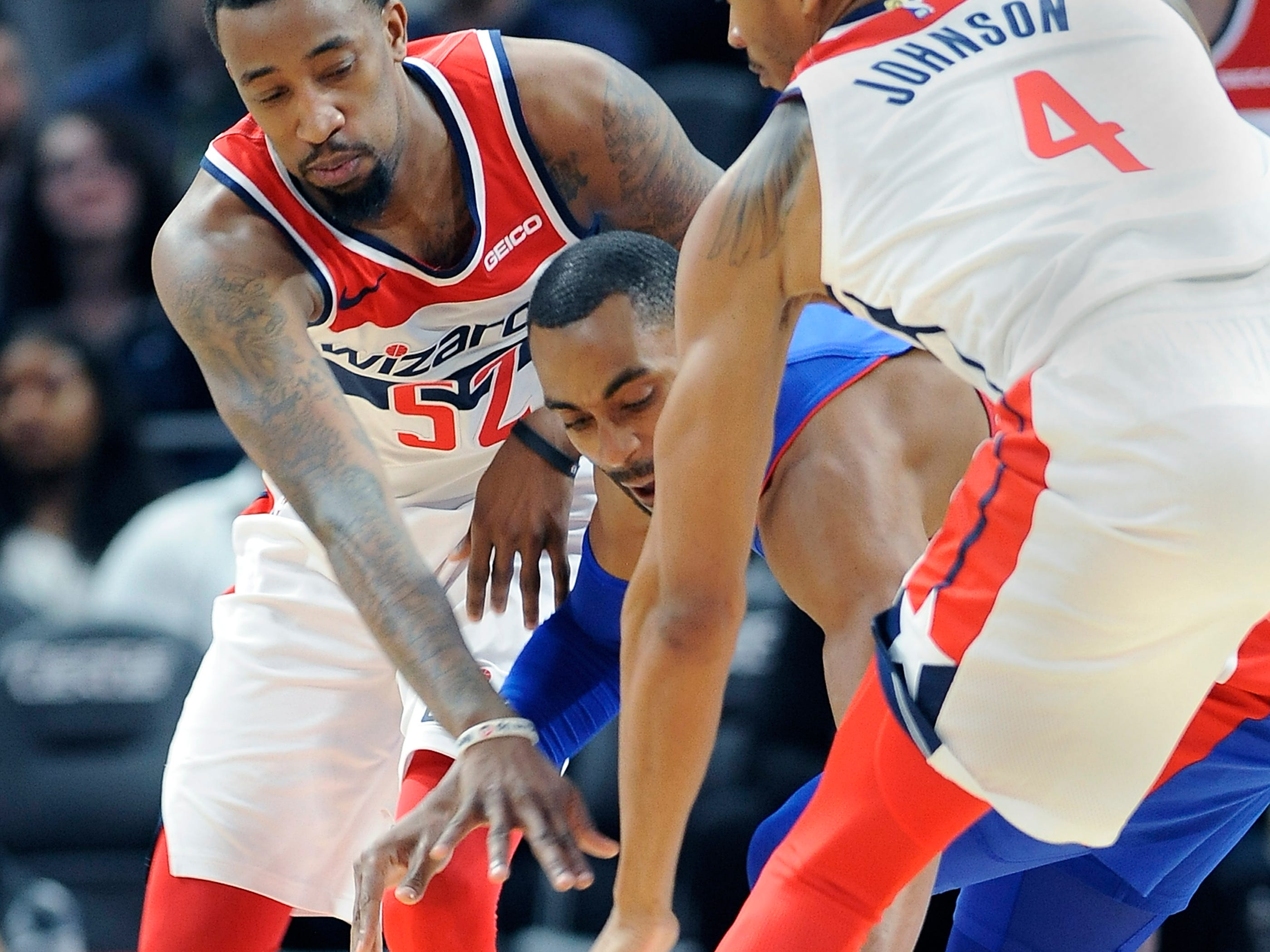 Wizards' l-r, Jordan McRae and Wesley Johnson double team Pistons' Wayne Ellington in the fourth quarter.