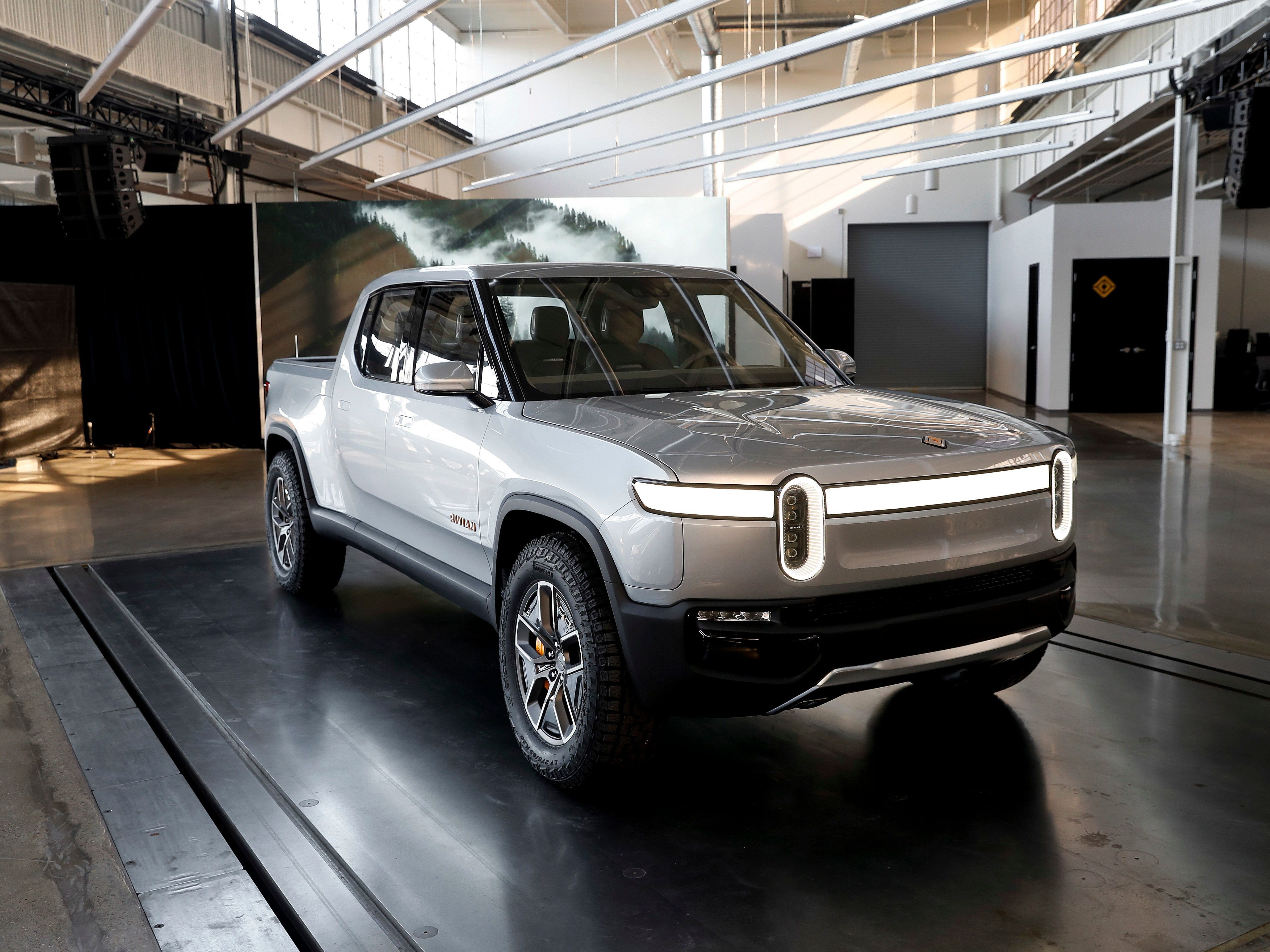 The fully electric Rivian R1T pickup. GM and Amazon are reportedly in talks to invest in the Plymouth-based company.