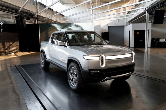 The fully electric Rivian R1T pickup. GM and Amazon are reportedly in talks to invest in the Plymouth, Mich.-based company.