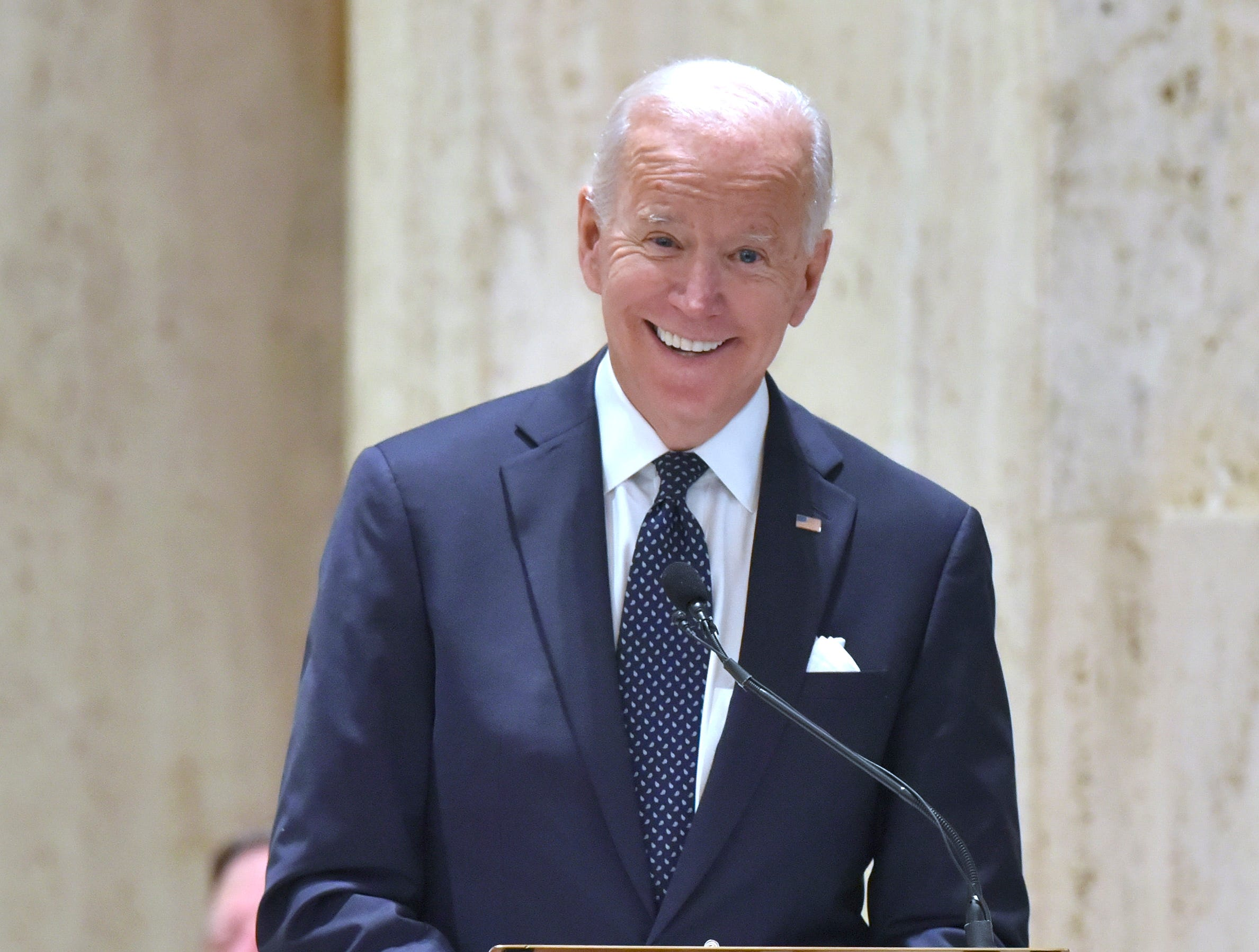 Former U.S. Vice President Joe Biden tells a joke during his speech.