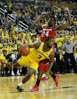 Zavier Simpson, who has been doing a better job at picking his spots on when to shoot three-pointers, is a big reason for the recent uptick on offense for Michigan.