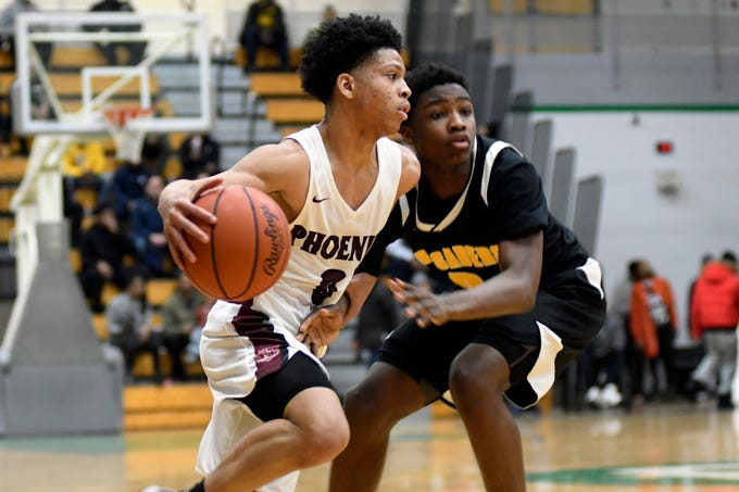 Detroit Renaissance's Keon Henderson (0) goes to the basket past Detroit King guard Chancey Willis Jr. (2) during the second quarter of the PSL boys basketball semifinals at Cass Tech High School in Detroit on Feb. 12, 2109. Renaissance defeated King, 55-46.