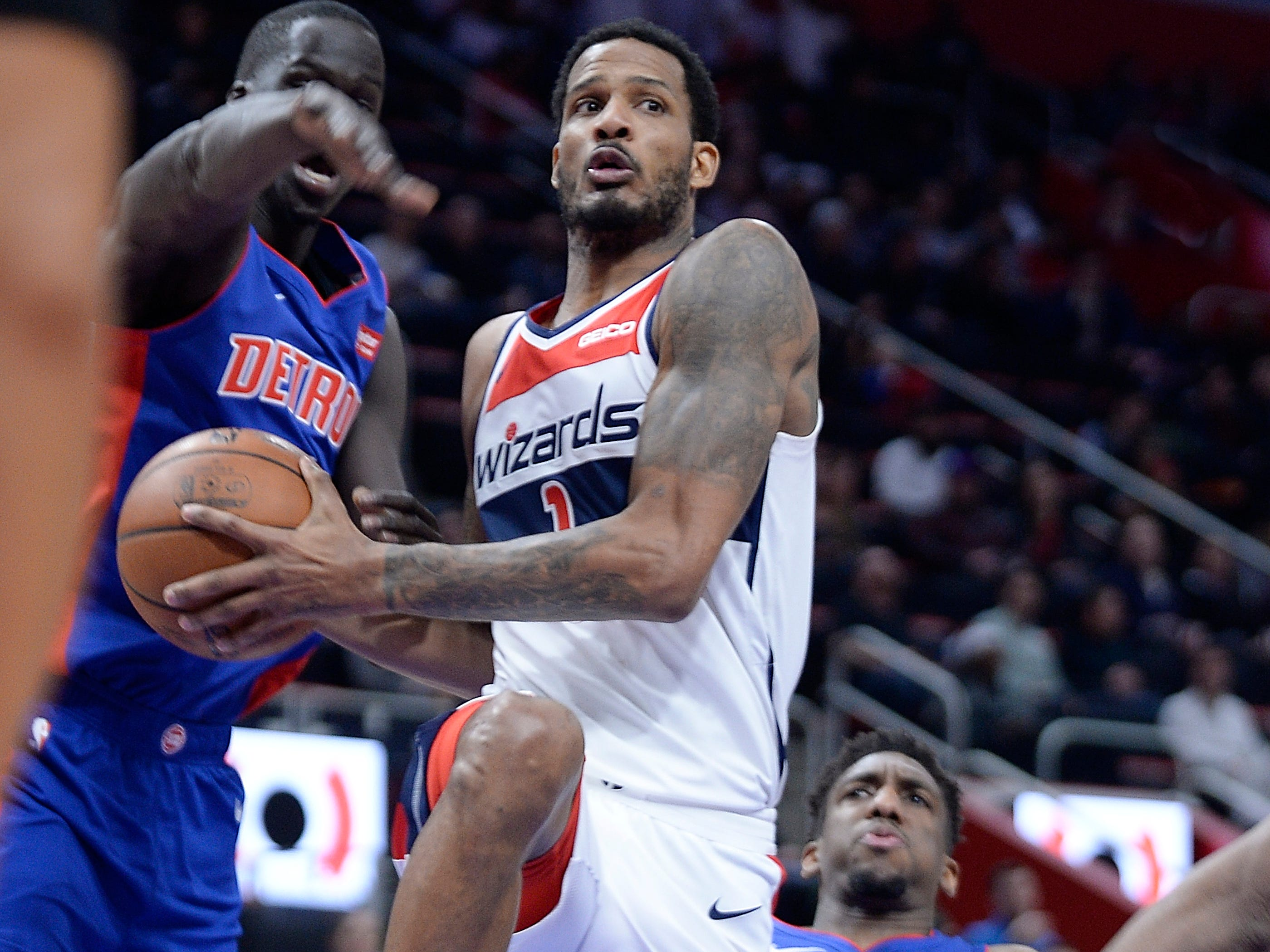 Wizards' Trevor Ariza (1) drives around Pistons' Thon Maker and Langston Galloway (9)in the third quarter.