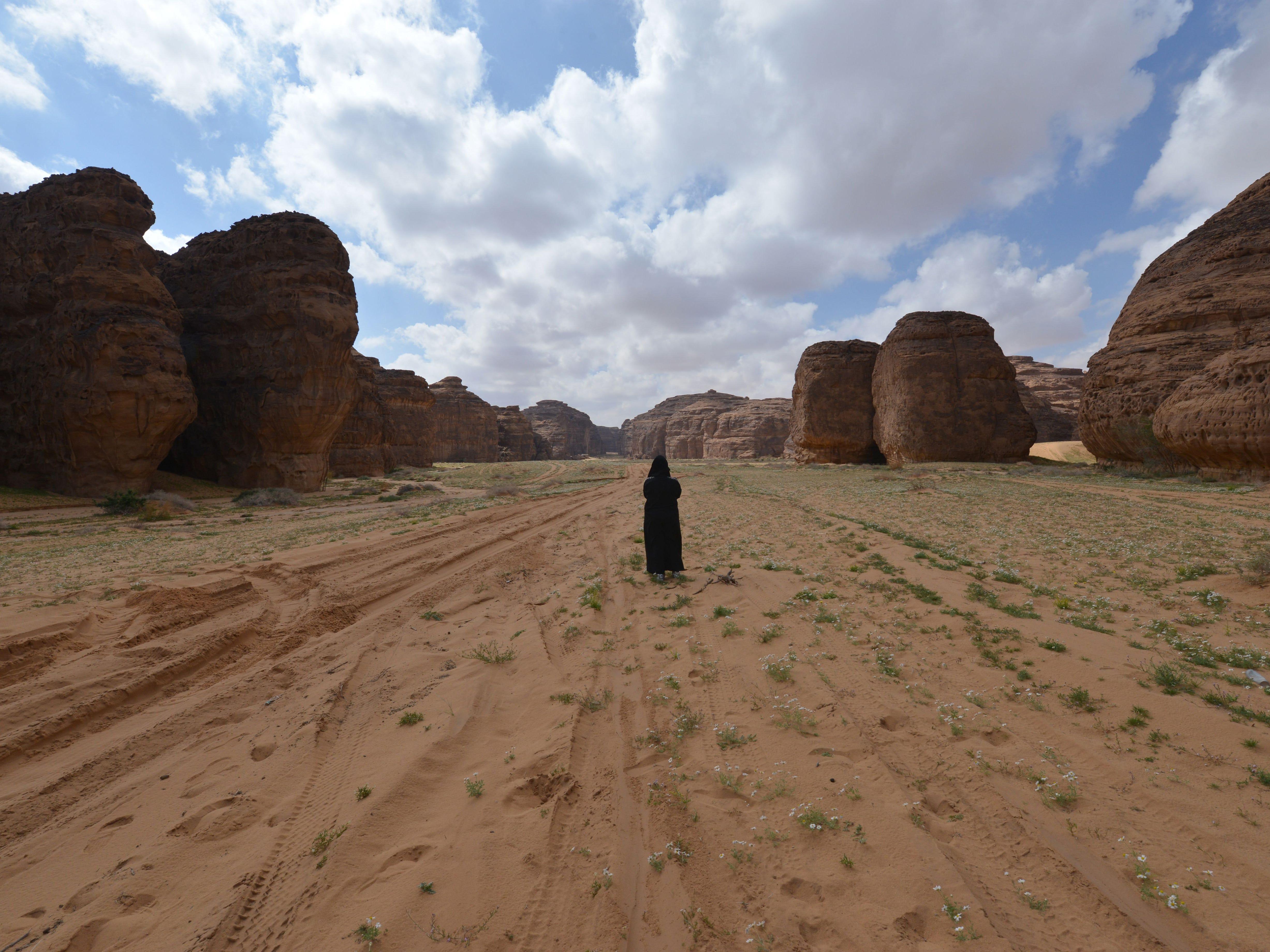 A woman walks in the Sharaan Nature Reserve near the town of al-Ula in northwestern Saudi Arabia on Feb. 11, 2019.