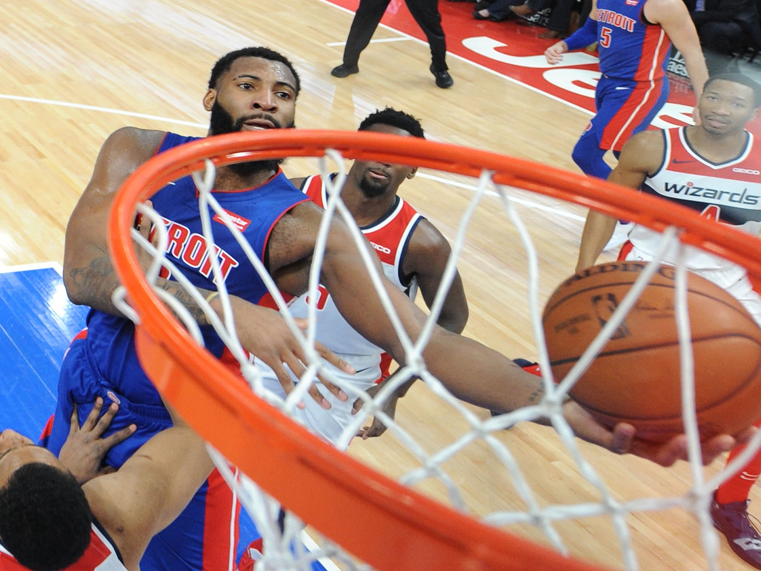 Pistons' Andre Drummond scores over Wizards' Jabari Parker in the fourth quarter.