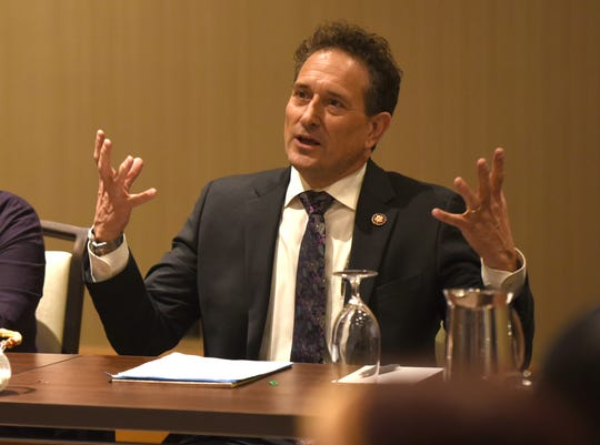 Congressman Andy Levin and Congresswoman Elissa Slotkin speak to federal employees as they haven't collected a paycheck due to the government shutdown during a round table meeting at Detroit Metropolitan Airport on Friday, January 11, 2019.