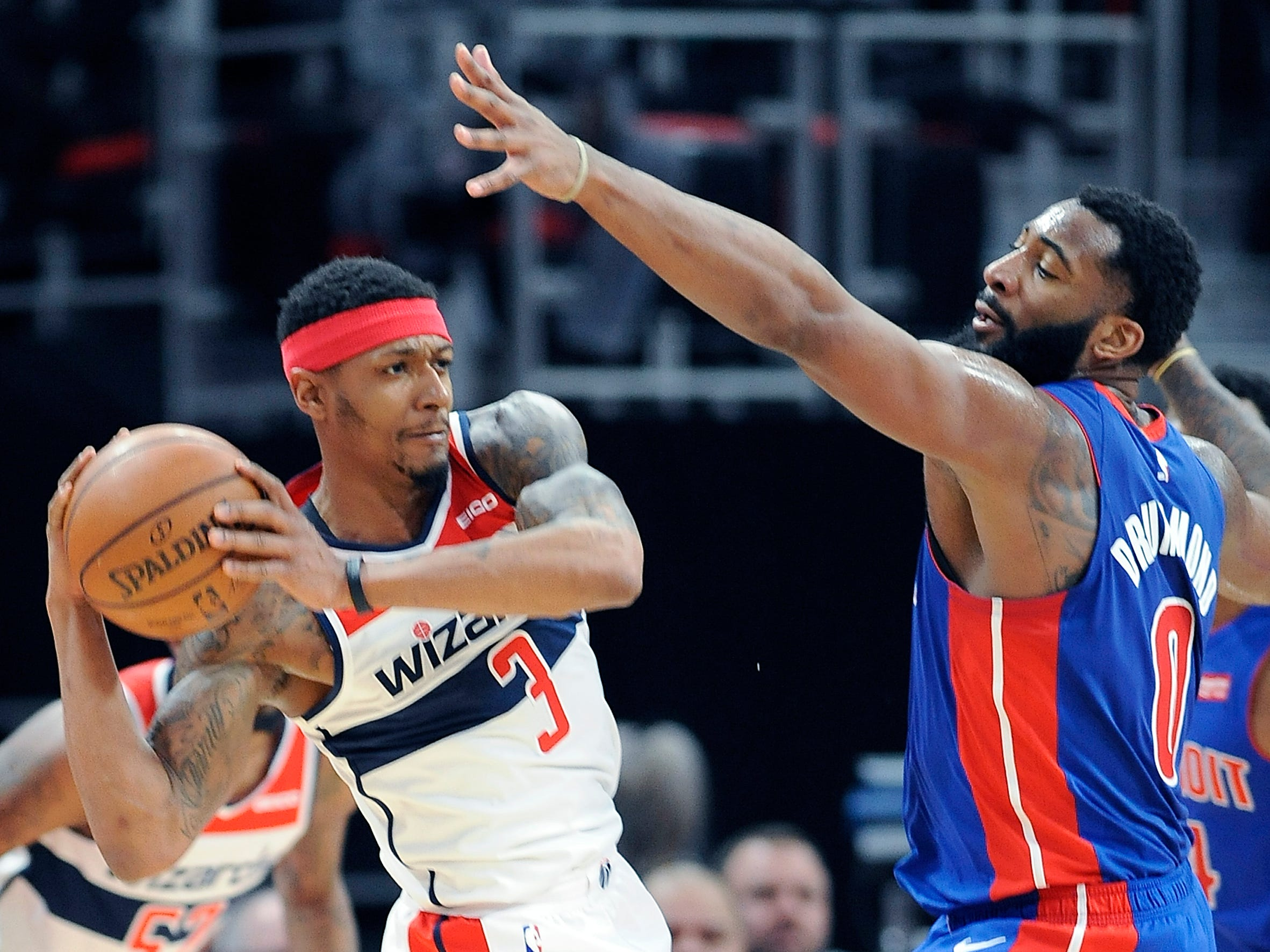 Pistons' Andre Drummond defends Wizards' Bradley Beal in the second quarter. Detroit Pistons win, 121-112, over the Washington Wizards, Little Caesars Arena., Feb. 11, 2019, Detroit, Mi.