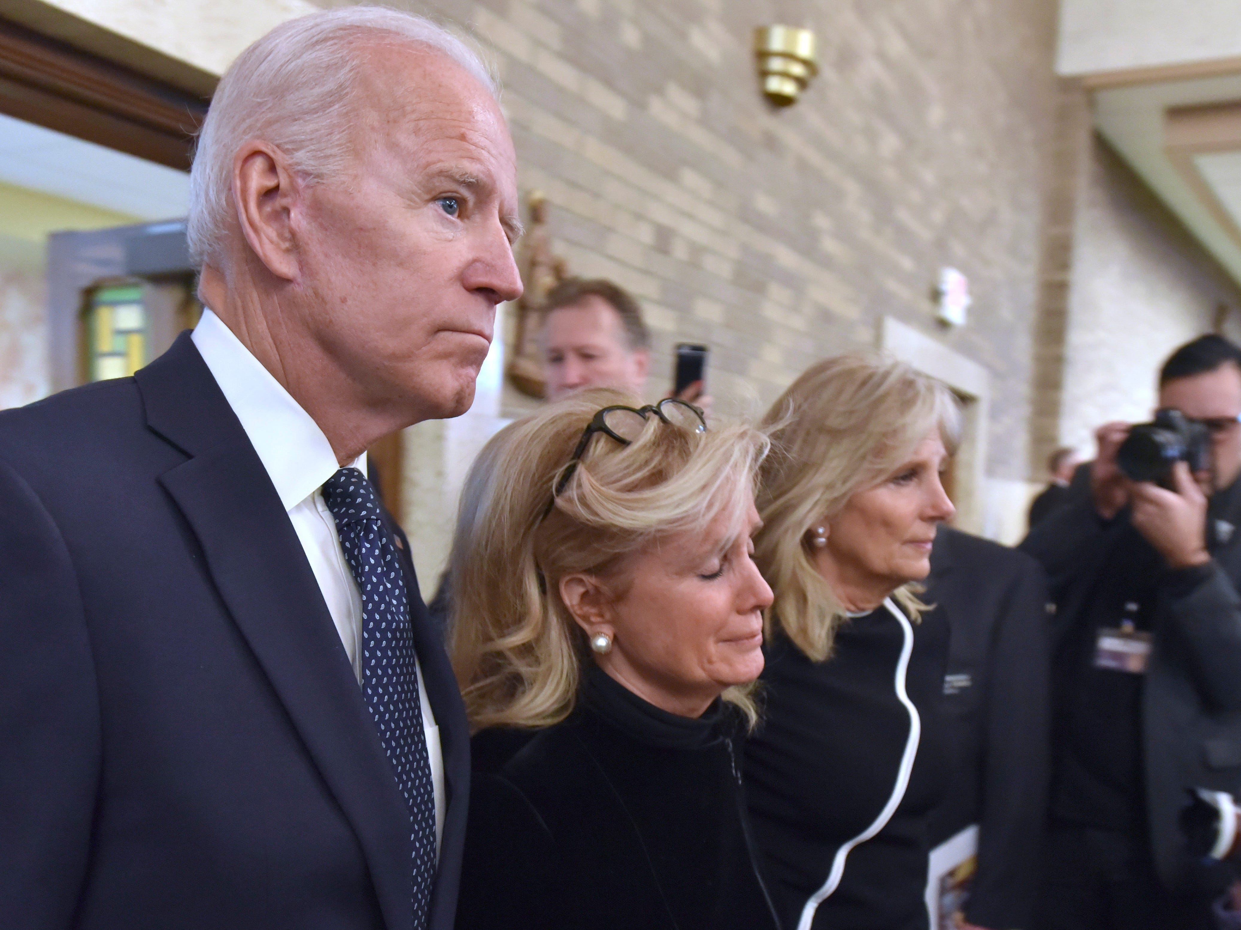 Former U.S. Vice President Joe Biden, left, escorts U.S. Rep. Debbie Dingell, center, widow of former U.S. Rep.  John Dingell, into the sanctuary at the Church of the Divine Child in Dearborn, Tuesday, Feb. 12, 2019, for Dingell's funeral service.