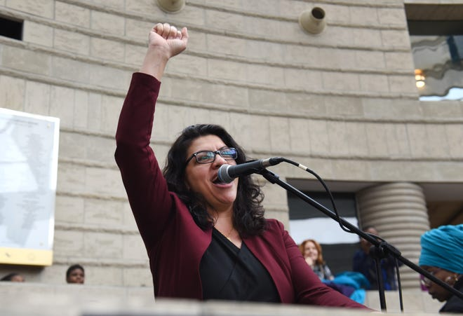 Congresswoman Rashida Tlaib raised her fist in solidarity in front of hundreds gather at the Charles Wright Museum of African American History for the Women's March Michigan on Saturday, January 19, 2019.
