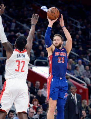 Pistons' Blake Griffin hits a 3-pointer over the Wizards' Jeff Green in the second quarter. Griffin finished with 31 points in a 121-112 Detroit victory Monday at Little Caesars Arena.