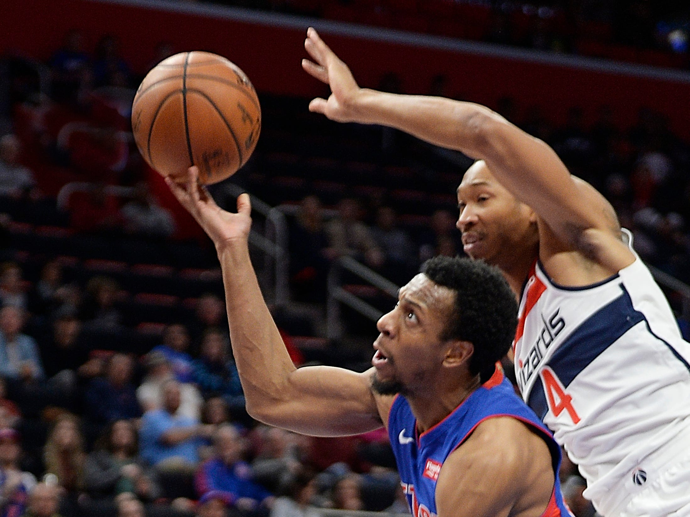 Pistons' Ish Smith shoots over Wizards' Wesley Johnson in the second quartrer. Smith was fouled on the play.