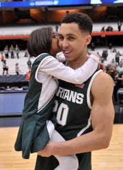 "Travis Trice's sister Ace gives him a big kiss as MSU beats Louisville, 76-70, in their NCAA ""Elite Eight"" game at the Carrier Dome in Syracuse, NY on Sunday, March 29, 2015. (Dale G Young/Detroit News)"