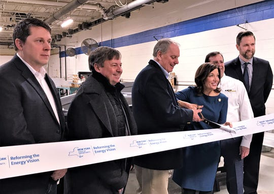 Parr Wiegel, founder and CEO of clean energy company EkoStinger, joins Lt. Gov. Kathy Hochul and others to cut the ribbon Thursday for EkoStinger's new Big Flats facility.