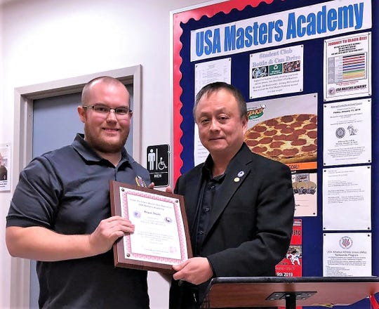 Brandon Clark, left, joined by Grandmaster Kenny Kuek, was officially recognized as the new chief instructor and manager of USA Masters Academy Corning-Painted Post.