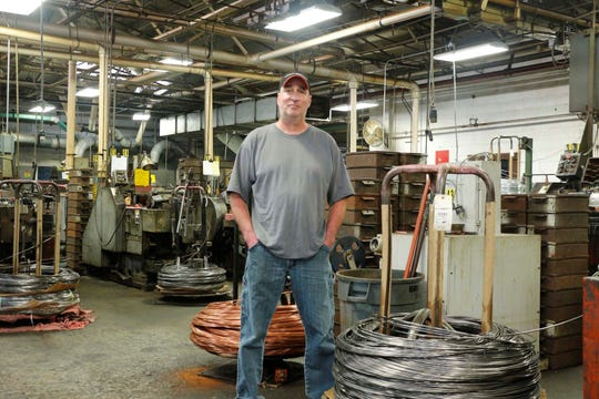Bill Kuslits stands inside National Rivet & Manufacturing Co. He has been part of the company for nearly 29 years.