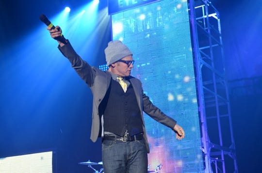 TobyMac gets the crowd involved in a concert at the Huntington Center in 2014.