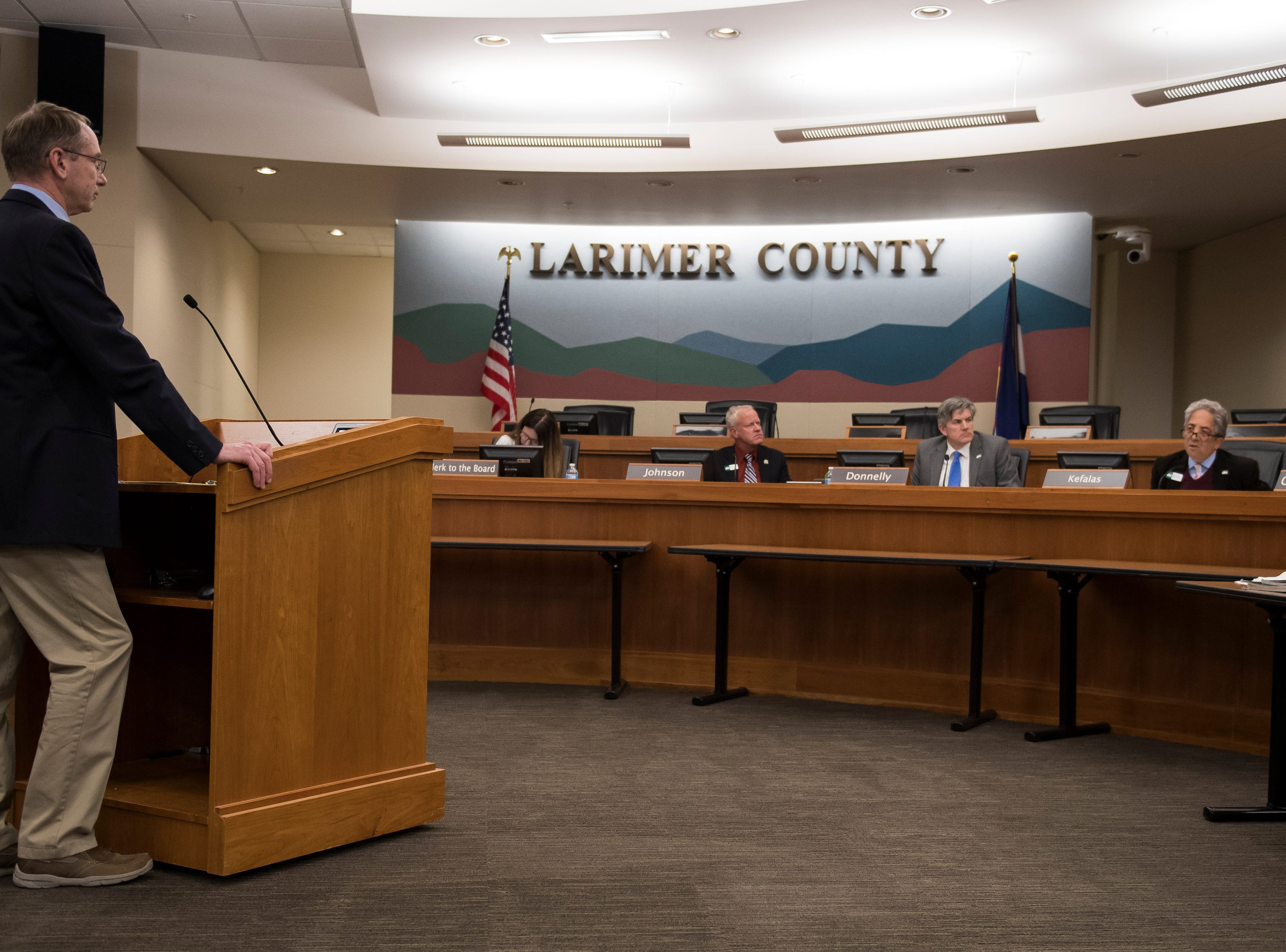 Director of the Thornton Water Project Mark Koleber, left, is asked questions by Larimer County District one commissioner John Kefalas before the county commissioners ultimately voted against the current proposal for construction of the Thornton pipeline on Monday, Feb. 11, 2019, in Fort Collins, Colo.