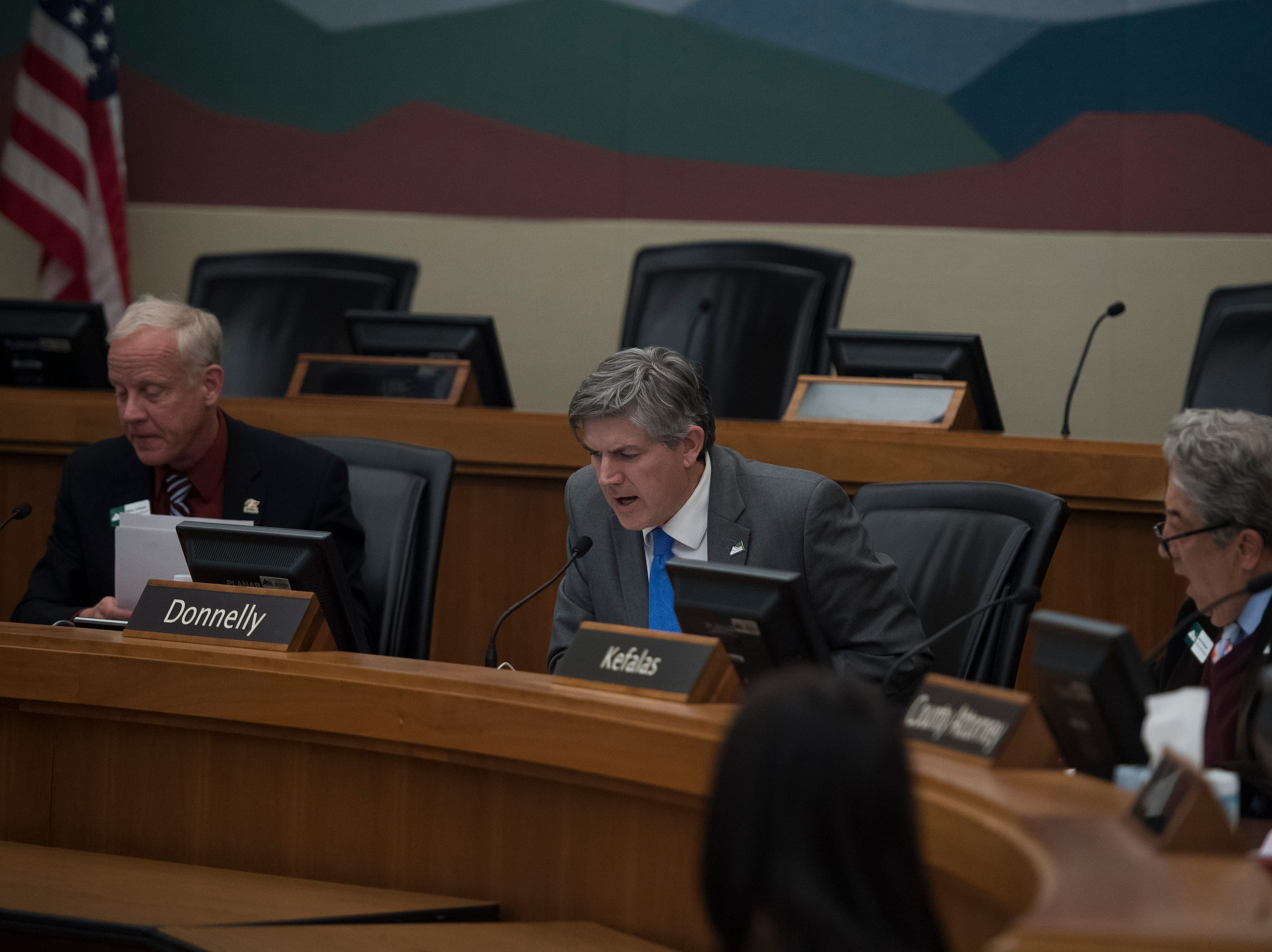 Larimer County Commissioners Tom Donnelly, center, and John Kefalas, right, second a proposal to by District two commissioner Steve Johnson, left, to not allow the current construction proposition of the Thornton pipeline on Monday, Feb. 11, 2019, in Fort Collins, Colo.