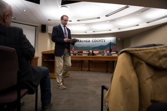 Director of the Thornton Water Project Mark Koleber heads back to his seat after being asked questions by Larimer County District one commissioner John Kefalas before the county commissioners ultimately voted against the current proposal for construction of the Thornton pipeline on Monday, Feb. 11, 2019, in Fort Collins, Colo.