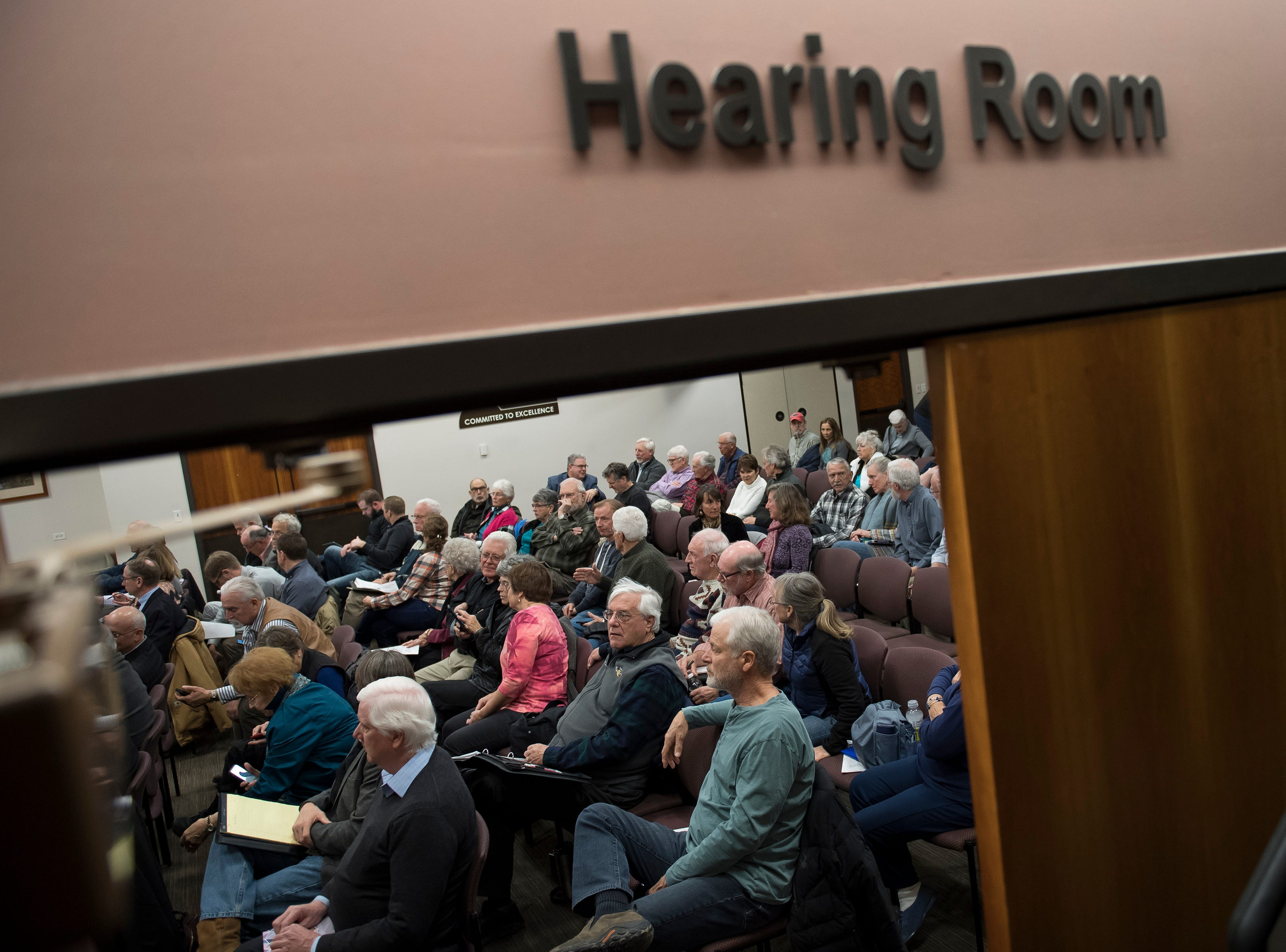 People fill the front half of the seats in the hearing room before a Larimer County Commissioners hearing where the commissioners voted against the current proposal for construction of the Thornton pipeline on Monday, Feb. 11, 2019, in Fort Collins, Colo.