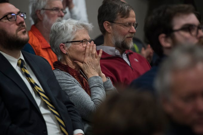 Fort Collins resident Karen Spencer reacts to Larimer County District three Commissioner Tom Donnelly's vote against the current proposition of the Thornton pipeline, following votes against the proposition by District one commissioner John Kefalas and District two commissioner Steve Johnson on Monday, Feb. 11, 2019, in Fort Collins, Colo.