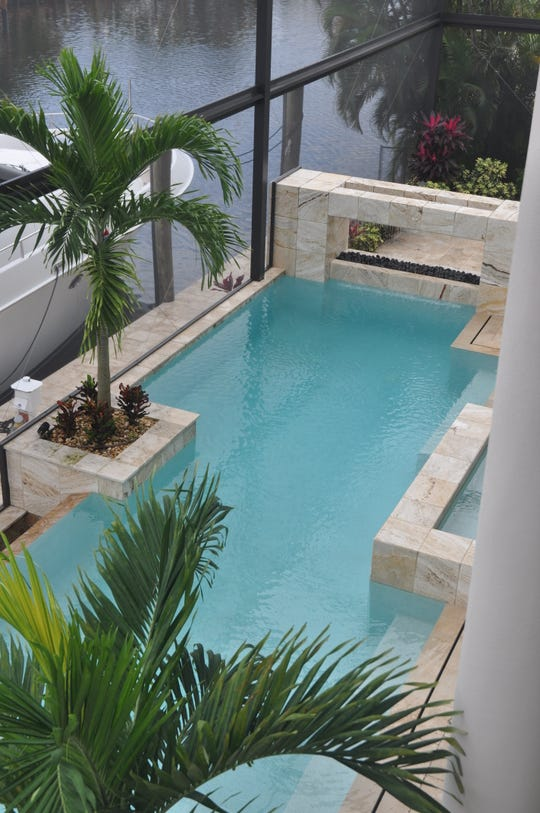 The pool has a waterfall and a fire element.