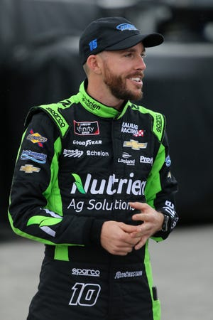 Ross Chastain, driver of the No. 15 Chevrolet, stands in the garage area  during practice for the Monster Energy NASCAR Cup Series 61st Annual Daytona 500 at Daytona International Speedway on Feb. 9 in Daytona Beach.