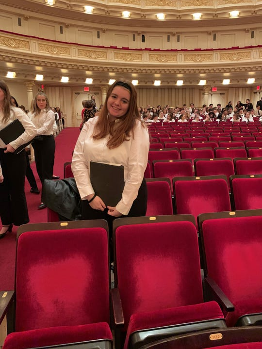 Katie Weinstein, 17, of Cape Coral's Oasis High School poses inside the historic Carnegie Hall in New York City.