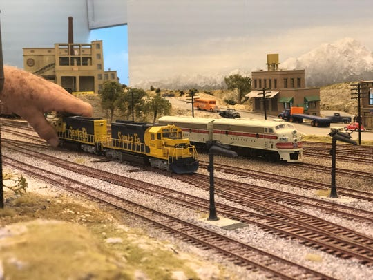 A club member adjusts a model train at Scale Rails of Southwest Florida.