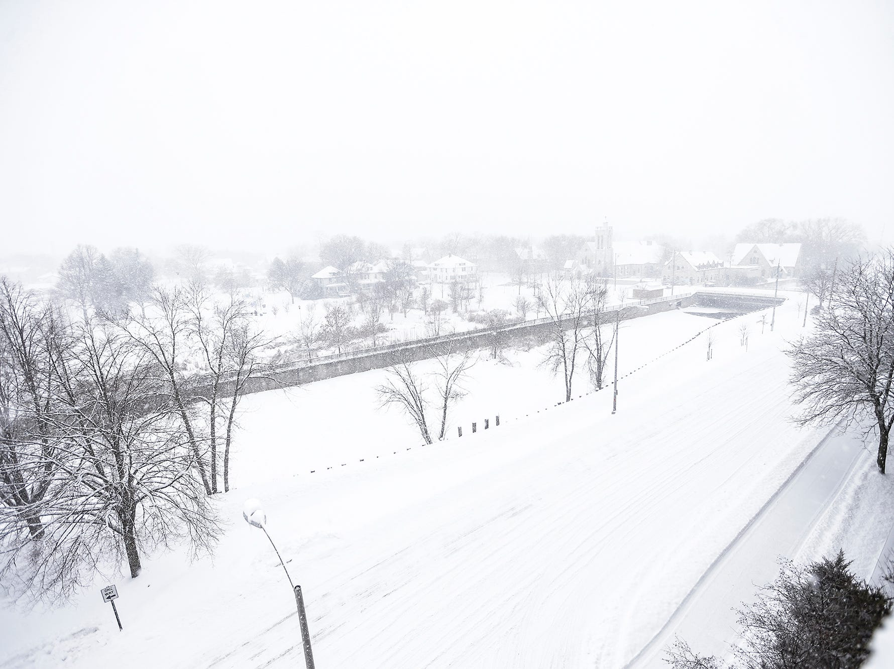 Visibility was reduced during a winter storm Tuesday, February 12, 2019 near downtown Fond du Lac, Wis. A winter storm warning was issued for the area.