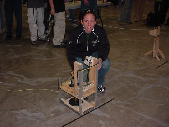 Rachael Winiecki pictured in April of 2003 at the Michigan Tech Engineering Olympics. She won a Silver medal for her catapult.