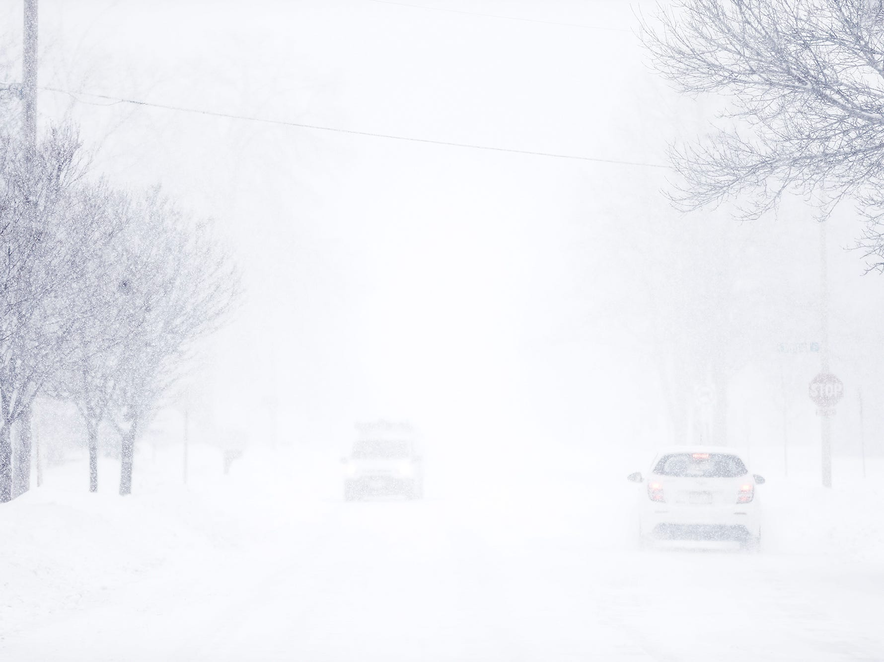 Visibility fell to less than a two blocks during a winter storm Tuesday, Feb. 12, 2019 in Fond du Lac, Wis. A winter storm warning was issued for the area.