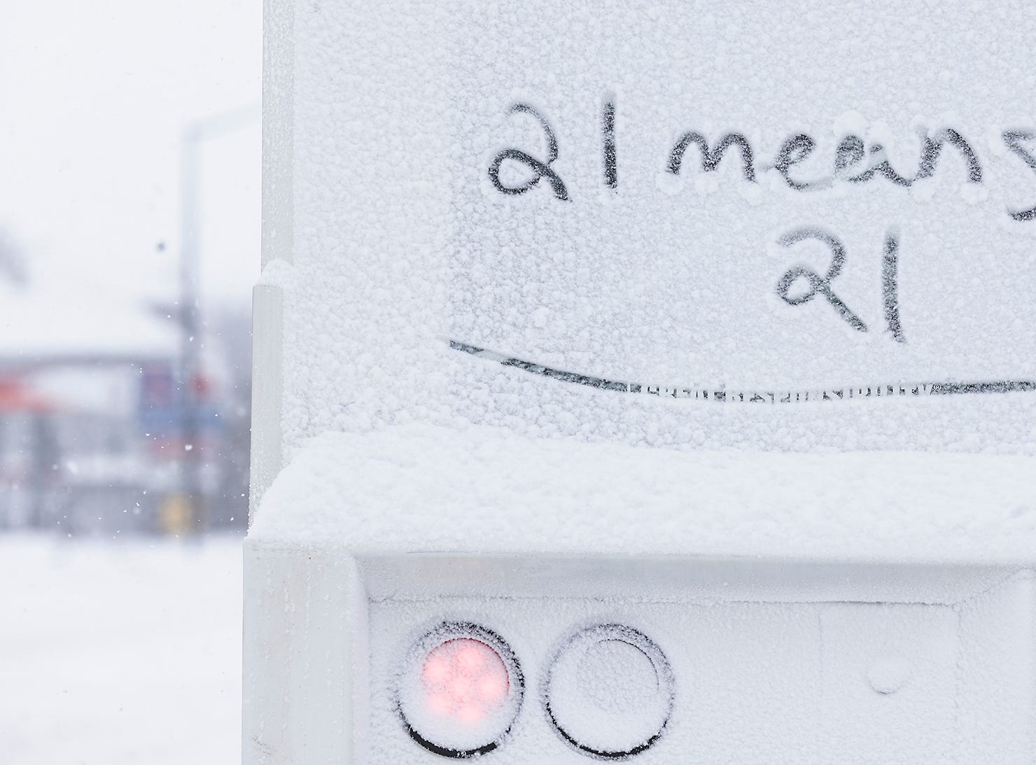 "Someone wrote ""21 means 21"" in the snow on a Lee Beverage beer truck during a winter storm Tuesday, Feb. 12, 2019, in Fond du Lac, Wis. A winter storm warning was issued for the area."