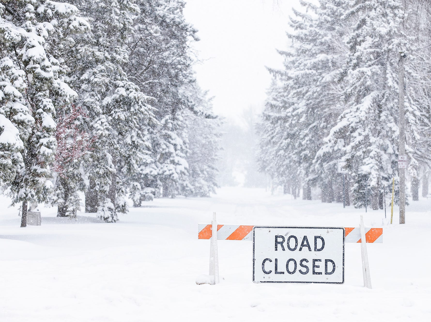 The nouth Main Street entrance to Lakeside Park is closed during a winter storm Tuesday, Feb. 12, 2019 in Fond du Lac, Wis. A winter storm warning was issued for the area.