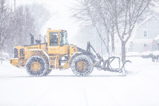 A city sno plow clears roads during a winter storm Tuesday, February 12, 2019 in Fond du Lac, Wis. A winter storm warning was issued for the area.