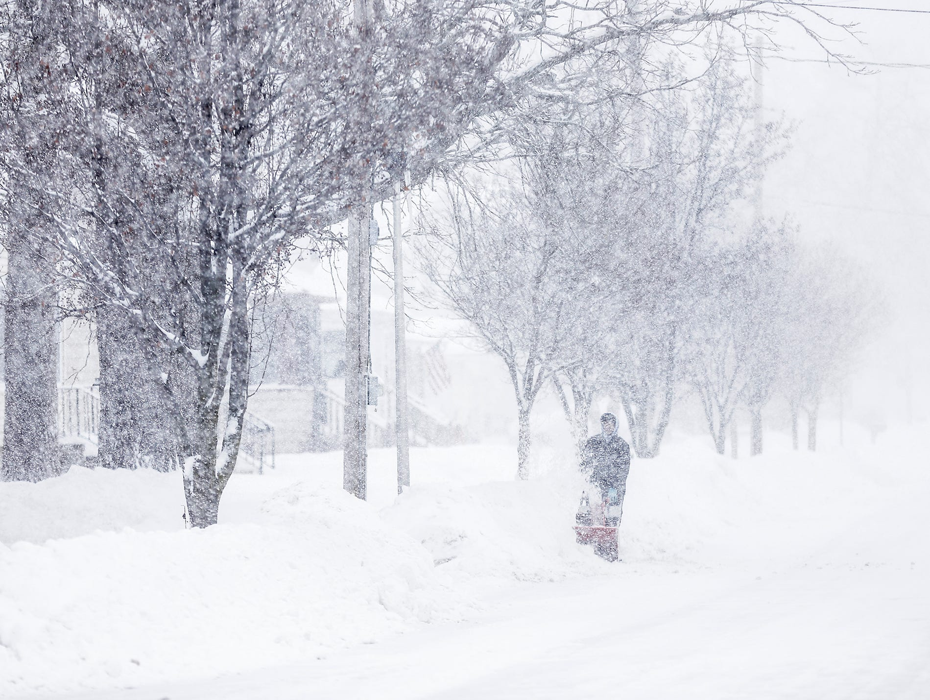 Aerion Hojem snowblows his Seymour Street driveway during a winter storm Tuesday, Feb. 12, 2019, in Fond du Lac, Wis. A winter storm warning was issued for the area.