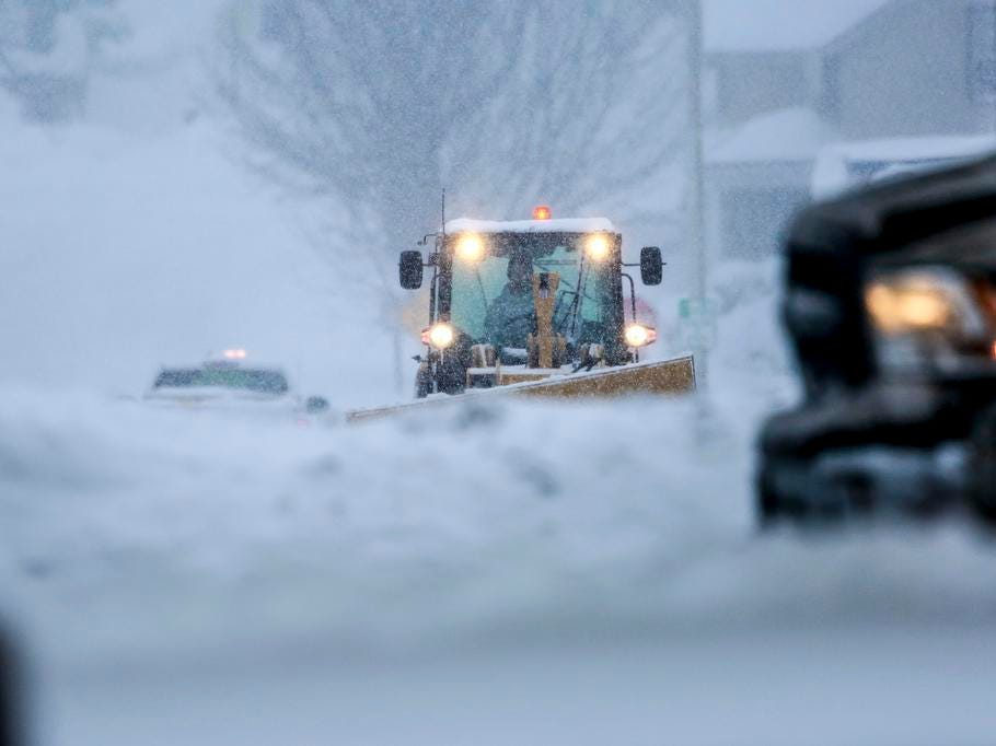 A construction vehicle plows snow during a snowstorm Tuesday, Feb. 12, 2019, on Callon Street in Wausau, Wis.
