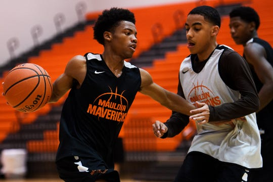 Mauldin's A.J. Jackson (11) attempts to advance during practice at Mauldin High School on Monday, Feb. 11, 2019.