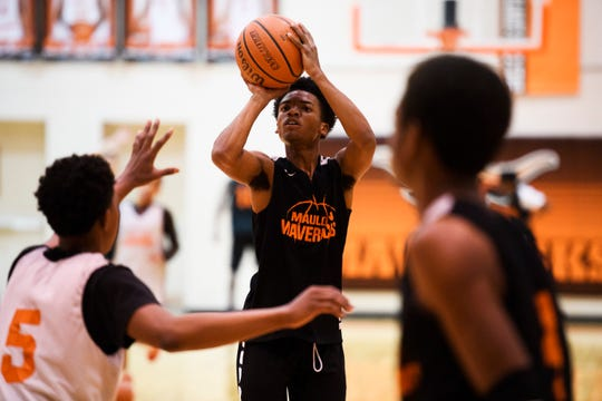 Mauldin's A.J. Jackson (11) attempts to shoot the ball during practice at Mauldin High School on Monday, Feb. 11, 2019.