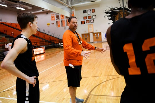 Mauldin head coach Adam McClain speaks to his players during practice at Mauldin High School on Monday, Feb. 11, 2019.